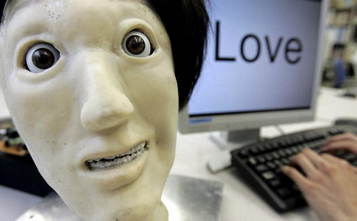 "A humanoid robot named Kansei, meaning ""sensibility"" in Japanese, makes a facial expression depicting ""happiness"", next to the word ""Love"" during a demonstration at a laboratory of Meiji University's Robot and Science Institute in Kawasaki, south of Tokyo in this June 4, 2007 file photo. Three-fourths of robot installations over the next decade are expected to be concentrated in four areas: transportation equipment, including the automotive sector; computer and electronic products; electrical equipment and machinery. Labor costs have climbed in countries such as China that have been popular for outsourcing production, while technological advances for robots allow them to be more flexible and perform more tasks. REUTERS/Yuriko Nakao/Files ATTENTION EDITORS - THIS PICTURE IS PART OF THE PACKAGE ""RISE OF THE MACHINES"". TO FIND ALL 20 IMAGES SEARCH 'TECHNOLOGY ROBOTS'."