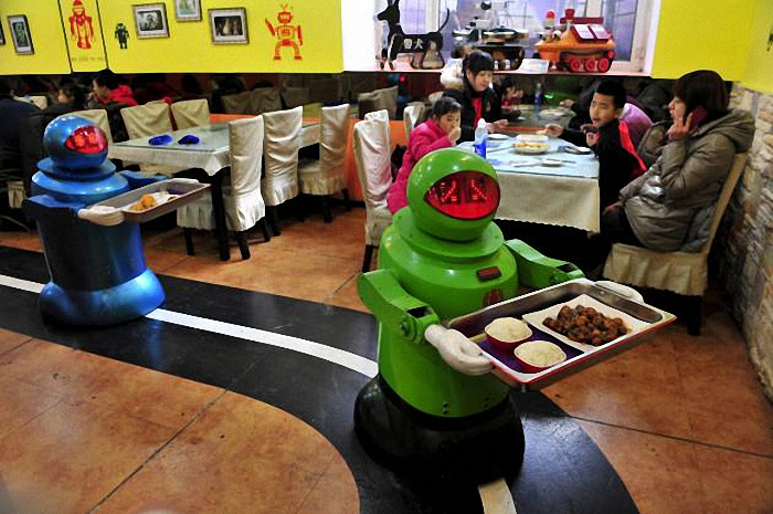 "Robots deliver dishes to customers at a Robot Restaurant in Harbin, Heilongjiang province in this January 12, 2013 file photo. Three-fourths of robot installations over the next decade are expected to be concentrated in four areas: transportation equipment, including the automotive sector; computer and electronic products; electrical equipment and machinery. Labor costs have climbed in countries such as China that have been popular for outsourcing production, while technological advances for robots allow them to be more flexible and perform more tasks. REUTERS/Sheng Li/Files  ATTENTION EDITORS - THIS PICTURE IS PART OF THE PACKAGE ""RISE OF THE MACHINES"". TO FIND ALL 20 IMAGES SEARCH 'TECHNOLOGY ROBOTS'."
