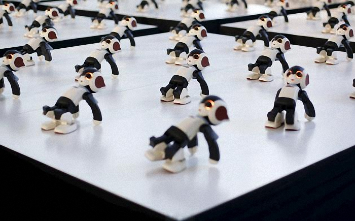 "A hundred humanoid communication robots called Robi perform a synchronized dance during a promotional event called 100 Robi, for the Weekly Robi Magazine, in Tokyo, in this January 20, 2015 file photo. Three-fourths of robot installations over the next decade are expected to be concentrated in four areas: transportation equipment, including the automotive sector; computer and electronic products; electrical equipment and machinery. Labor costs have climbed in countries such as China that have been popular for outsourcing production, while technological advances for robots allow them to be more flexible and perform more tasks. REUTERS/Yuya Shino/Files ATTENTION EDITORS - THIS PICTURE IS PART OF THE PACKAGE ""RISE OF THE MACHINES"". TO FIND ALL 20 IMAGES SEARCH 'TECHNOLOGY ROBOTS'."