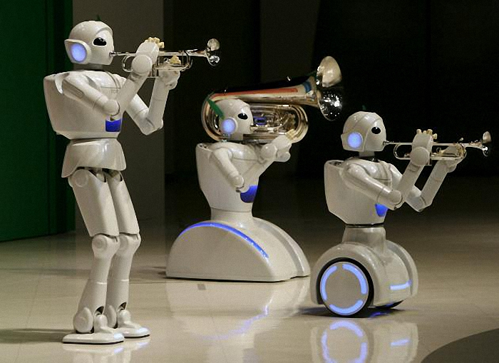 "Toyota Motor Corp's partner robots play instruments at the company's showroom in Tokyo, in this May 4, 2008 file photo. Three-fourths of robot installations over the next decade are expected to be concentrated in four areas: transportation equipment, including the automotive sector; computer and electronic products; electrical equipment and machinery. Labor costs have climbed in countries such as China that have been popular for outsourcing production, while technological advances for robots allow them to be more flexible and perform more tasks. REUTERS/Toru Hanai/Files ATTENTION EDITORS - THIS PICTURE IS PART OF THE PACKAGE ""RISE OF THE MACHINES"". TO FIND ALL 20 IMAGES SEARCH 'TECHNOLOGY ROBOTS'."